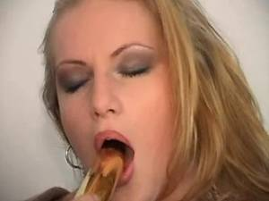 Chubby busty babe enjoys gold dildo