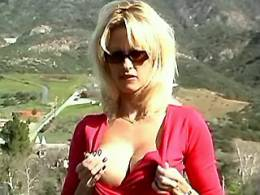 Sexy blond in sunglasses masturbates outdoors