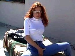 Sexy horny redhead lezzie satisfies herself outside