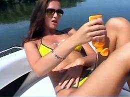 Lezzie plays with her pretty young body in a boat
