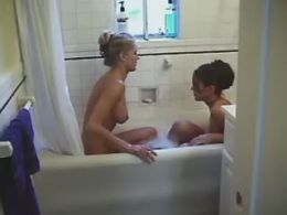 lesbians play sex game in bathroom