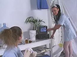 Two nice nurses licking each other