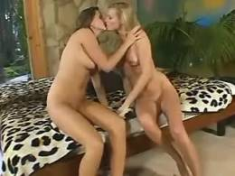 Sexy lezzie drills another with finger